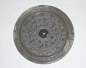 A Rare Bronze Mirror with Archaic Motifs