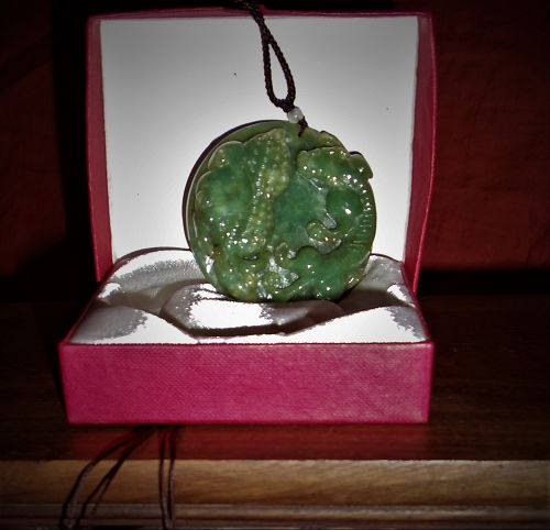 An Exquisite Qing Dynasty Green Jade Pedant with Auspicious Reliefs