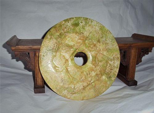 A Rare Majestic Jade Disc with Archaic Dragon-Kilin Relief-Motifs