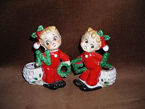 COUPLE OF GIRLS CANDLE HOLDERS