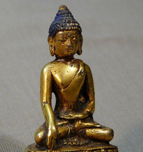Cast bronze Buddha gilded. Tibet