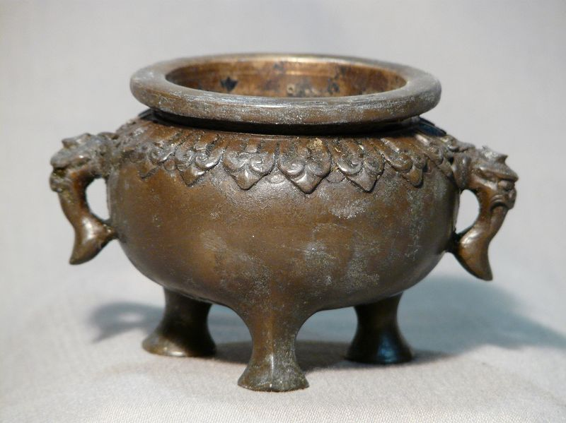 Small Chinese or Japanese cast bronze tripod censer.