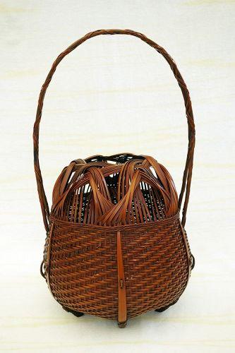 A Japanese modern bamboo basket Ikebana.