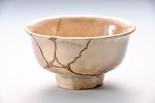 An Edo Period Seto Shuhai (Saké Cup) with Gold Repairs