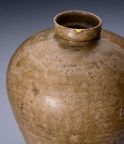 A Joseon Period Korean Vase with Gold Repairs