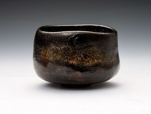 A Classic Black Raku Tea Bowl by Akazawa Seiho