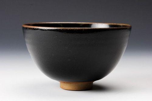 A �Koyo� Tenmoku Tea Bowl with Silk Pouch by Touetsu Kiln
