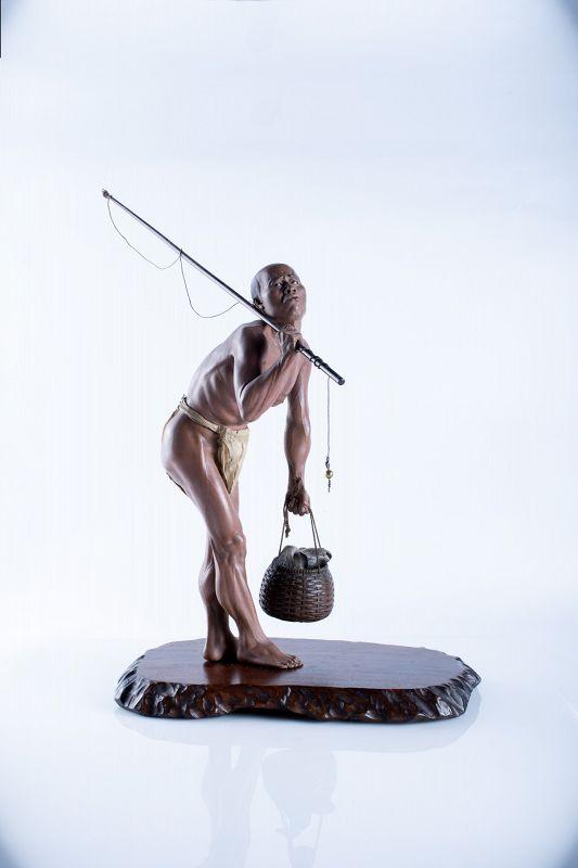 A Japanese Iki-ningyō sculpture okimono of a fisherman