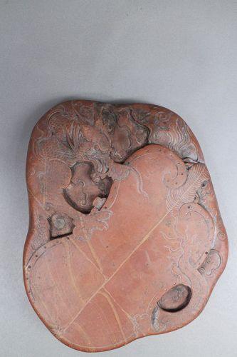 Qing dynasty carved sea dragon inkstone