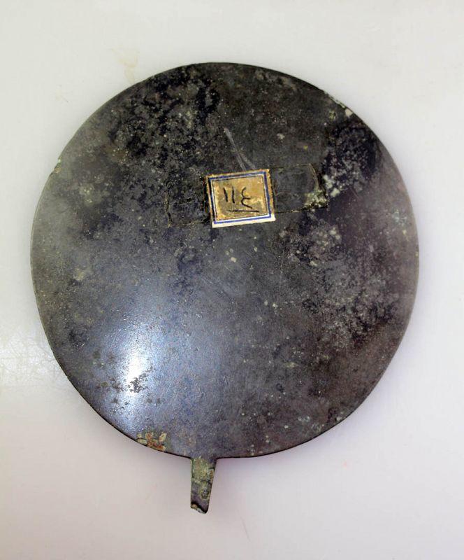 Large Islamic bronze mirror, 10th.-12th. century AD.