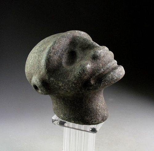 An Artful stone head of the Taino Culture, 1000-1300 AD.