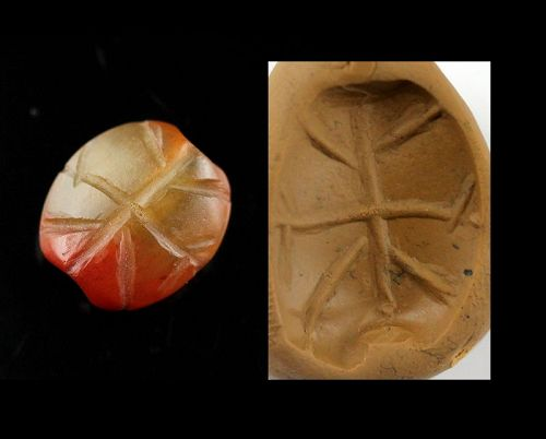A fine Neo-Assyrian stamp seal in mottled agate, 1st. millenium BC