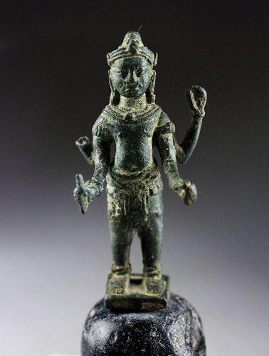 Khmer bronze figure of the 4-armed Vishnu Angkor period, 11th. c.