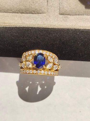 18K. Gold Ring set with Ceylon Blue Sapphire-Diamonds