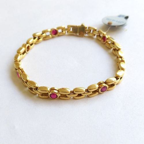 Solid 18. Gold Bracelet set with 7 Genuine Siam Rubies