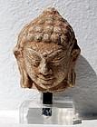 A HARIPUNCHAI Stucco Head of Buddha, 11th Century
