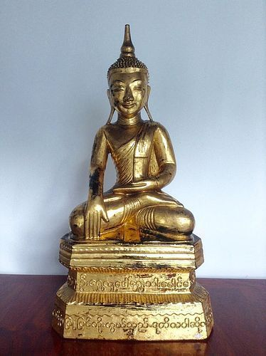 EXCEPTIONAL SHAN STATE GILT SOLID WOOD BUDDHA WITH SCRIPT, 19TH CENT.