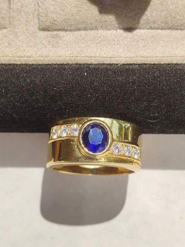 Blue Sapphire Ring with 6 Diamonds 18K