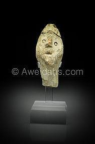Canaanite pottery head of god wearing a helmet