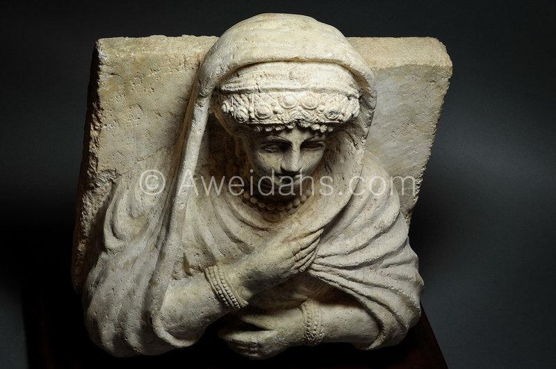 Roman limestone bust of a veiled female, 1st A.D
