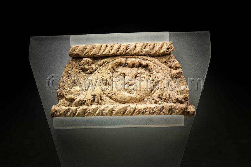 Ancient Roman bone fragment depicting cupid, 1st Cent AD