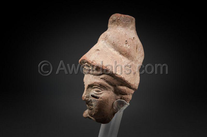 Ancient terracotta head of goddess Athena, 100 BC/AD