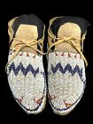 A pair of Ute Beaded Hide Moccasins