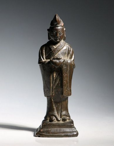 A Chinese Bronze Attendant L Ming