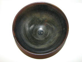 A Jian-type conical bowl with 'heir's fur' glaze.