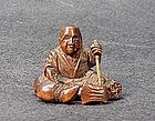 19th C. JAPANESE WOOD NETSUKE OF WOODCUTTER