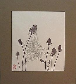 PAPER CUT-OUT OF A SPIDER WEB