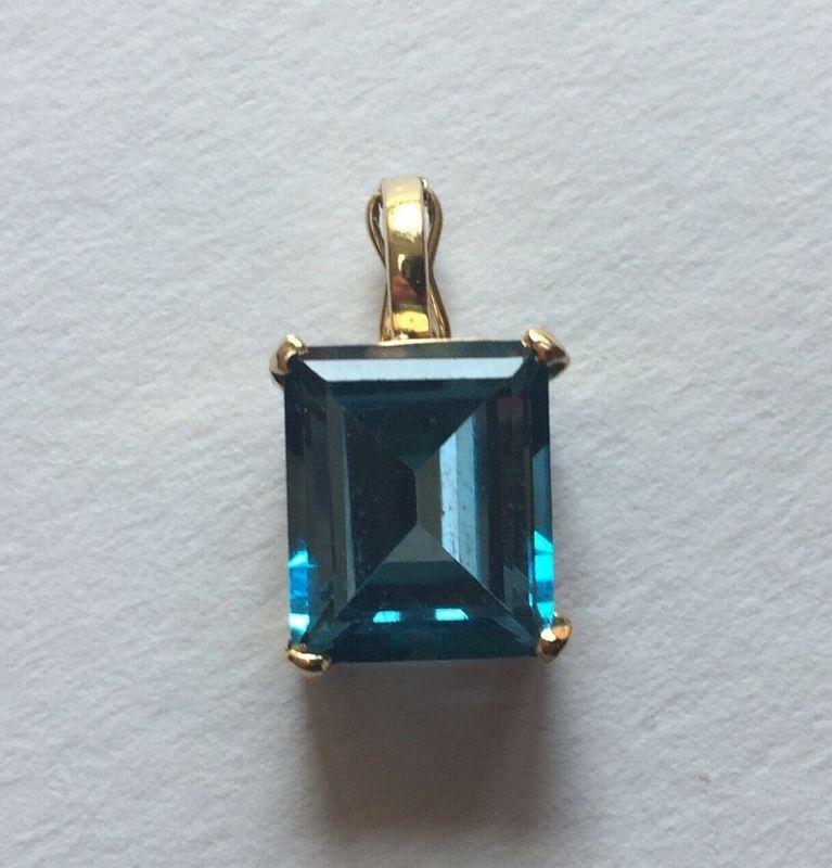 10K YG Emerald Cut Blue Topaz Enhancer