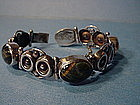 Signed TAXCO Mexican Sterling Tiger + Hawk Eye Bracelet