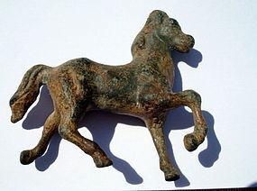 A ROMAN BRONZE FIGURE OF A HORSE