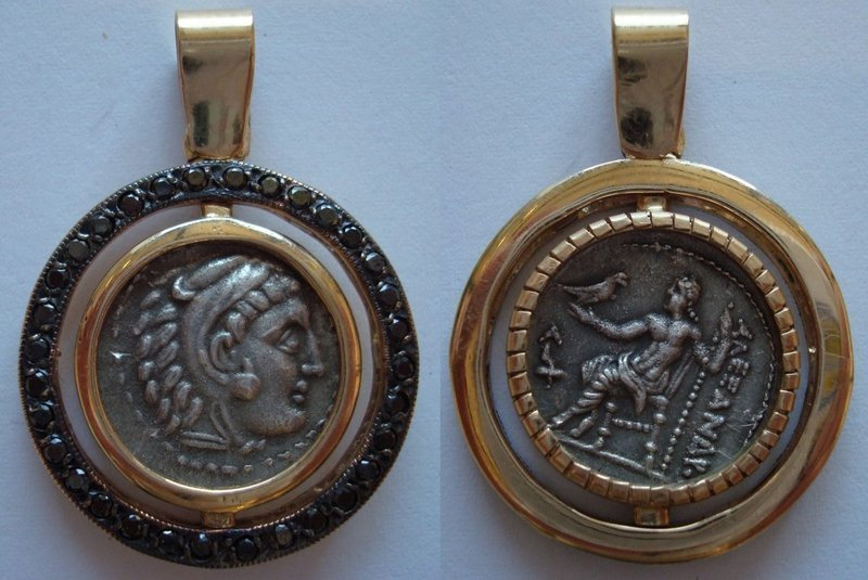 A SILVER DRACHM OF ALEXANDER THE GREAT SET IN 18K GOLD