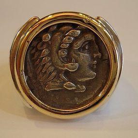 A SILVER TETRADRACHM OF ALEXANDER III SET IN 14K GOLD