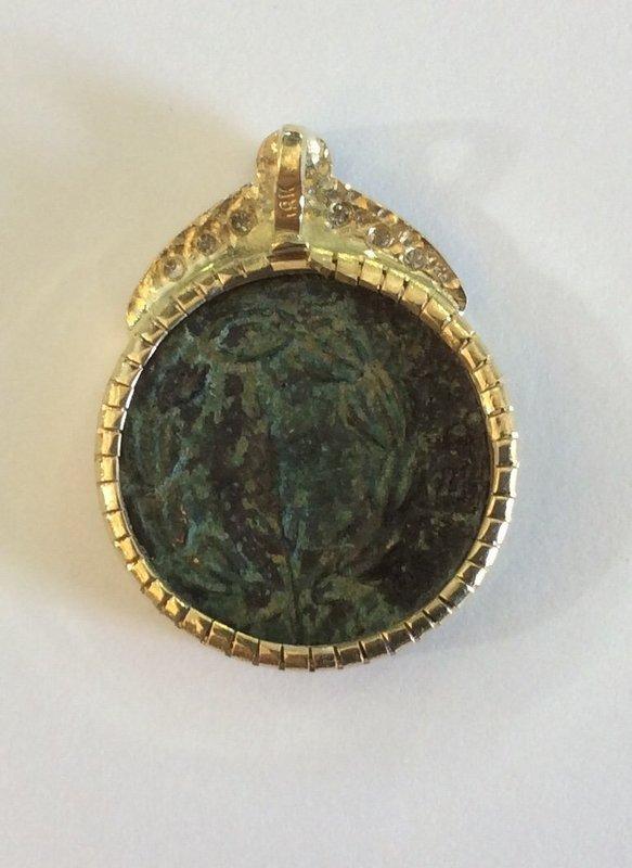 A BRONZE COIN OF THE BAR KOCHBA REVOLT IN 18K GOLD