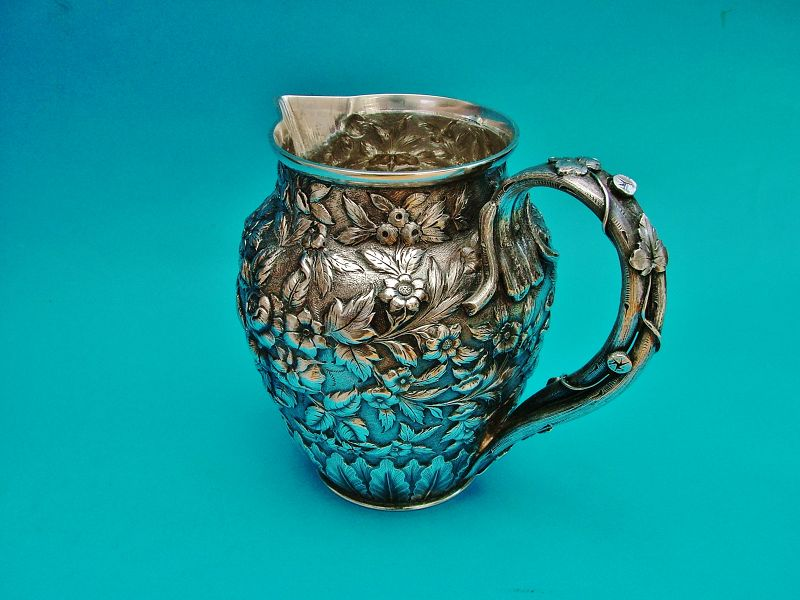 Peter Krider repoussé chased sterling bar pitcher,