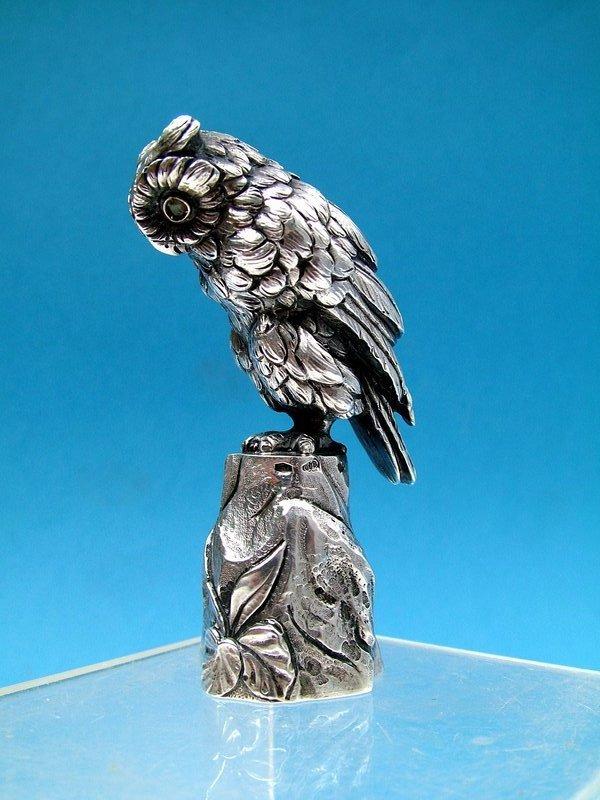a fine full figural owl desk seal,  pale emerald eyes