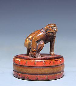 Japanese Red Lacquer Netsuke Figure; Oni, Edo Period.