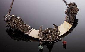 19 C. Indo/Tibetan Silver Dragon Boar Tusk Necklace.