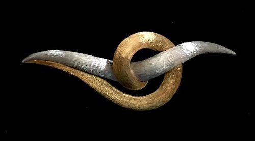 H. Dunay modernist 18K plat knot brooch