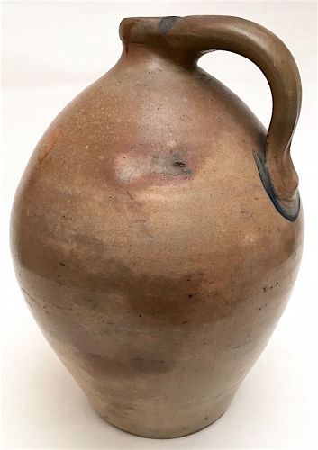 Antique ovoid stoneware jug with cobalt accents