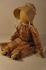 Pencil face prairie type cloth doll brown dress  tan bonnet antique