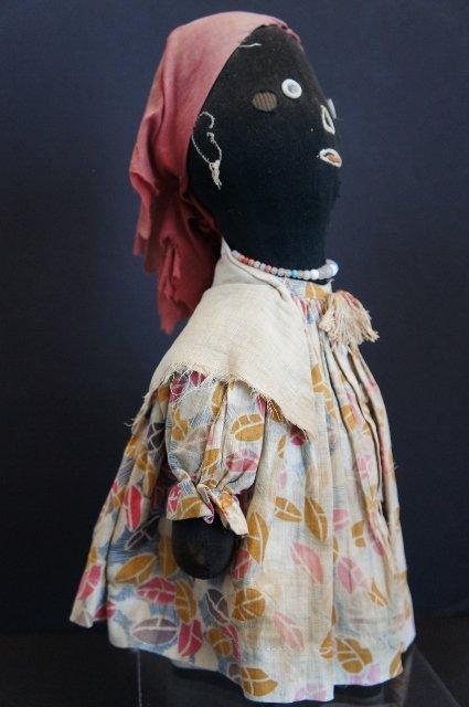 A great black bottle doll doorstop original clothes antique folk art
