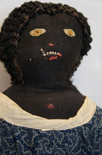 So nice black doll with golden brown eyes, blue calico dress 19th C.