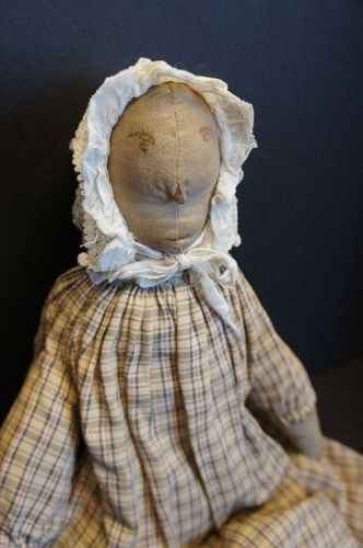 Her name is Ruby she is big strong ink drawn face cloth doll 22""