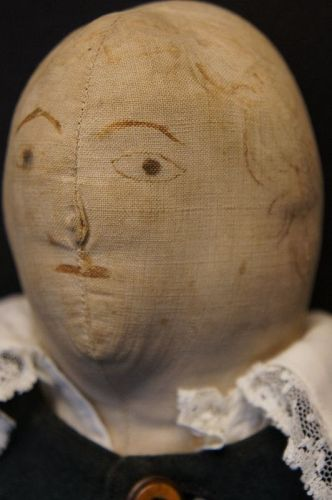 19th C. original boy doll with wool 2 piece suit, ink drawn face 20""