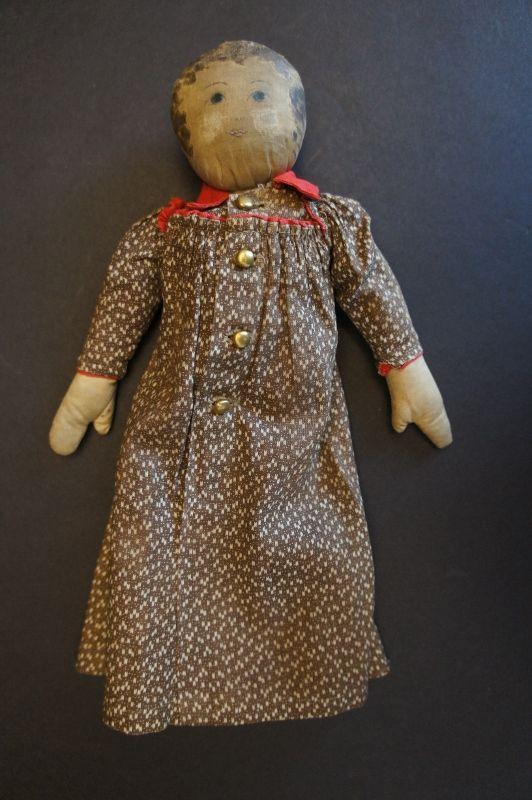 """A tiny adorable 11"""" babyland rag doll, brown calico dress Circa 1890"""