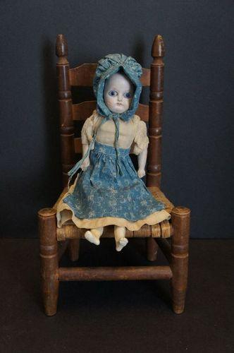 """Amazing squeak toy doll in original dress  bisque head glass eyes 11"""""""